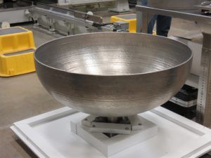 """Lockheed Martin Space Systems is using """"additive manufacturing"""" - better known as 3-D printing - to greatly decrease costs and lower production time when creating parts like this partially-built tank. Credit: Phillip Swarts"""