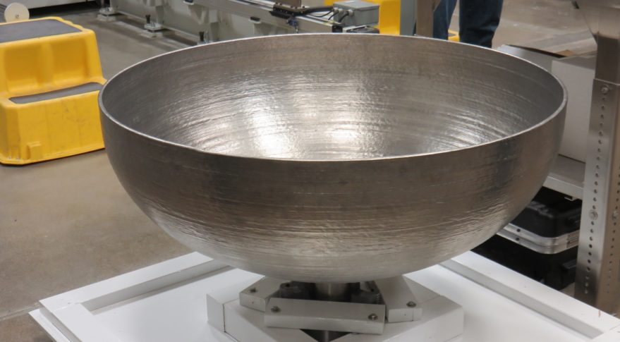 "Lockheed Martin Space Systems is using ""additive manufacturing"" - better known as 3-D printing - to greatly decrease costs and lower production time when creating parts like this partially-built tank. Credit: Phillip Swarts"