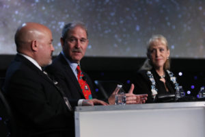 Jonathan Arenberg (L), John Mace Grunsfeld (C), and Mary Lynne Dittmar (R), discuss the potential of heavy launch for scientific exploration at the 33rd Space Symposium in Colorado Springs. Credit: Tom Kimmell