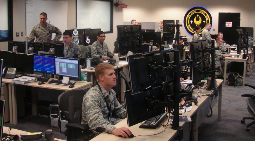 """Members of the 1st Space Operations Squadron operate satellites at the new combined ops floor at Schriever Air Force Base, Colorado, April 28, 2017. The Air Force wants the """"Space Flag"""" exercise to be a chance for airmen to hone their problem-solving and war-fighting skills. Credit:  Senior Airman Arielle Vasquez/U.S. Air Force"""