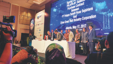 CGWIC and Pasifik Satelit Nusantara executives sign a contract for the Palapa-N1 satellite at the APSAT 2017 conference in Jakarta, Indonesia, in May. Credit: SpaceNews/Caleb Henry