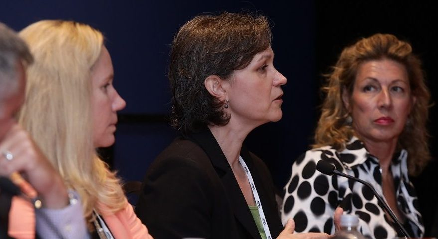 Diana Hughes (center), director of NGA's Office of Small Business, speaks at a panel at the GEOINT Symposium, June 6, 2017. Credit: Chuck Janda/USGIF