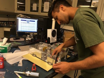Structures team member Raj Bansal assembling the CU-E3 prototype structure.