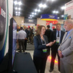 Karen Thomas (left), Harris Corp's chief Geographic Information Systems strategist, demonstrates the company's capabilities to National Geospatial-Intelligence Agency Director Robert Cardillo (right), at the GEOINT 2017 Symposium. Credit: Harris