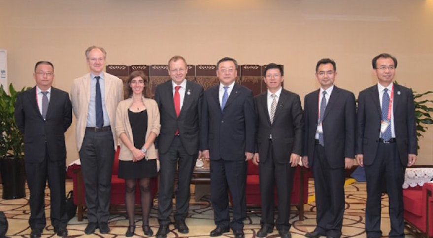 CNSA Administrator Tang Dengjie with ESA Director General Johann-Dietrich Woerner, pictured center, in Beijing on June 6.