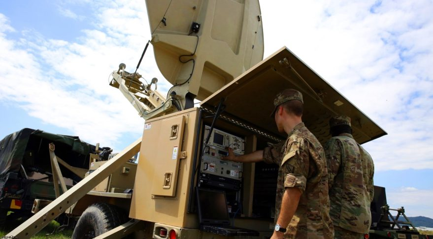 U.S. Army Spc. David Perkins and Sgt. Harrison Nichols of the 44th Expeditionary Signal Battalion, 2nd Theater Signal Brigade, set up a Satellite Transportable Terminal for a Command Post Node at a site near Stuparei, Romania, July 5, 2017. Credit: William King/U.S. Army