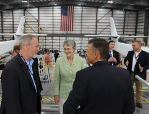Air Force Secretary Heather Wilson talks with Stratolaunch CEO Jean Floyd (left) at the company's hangar in Mojave, Calif. Credit: Heather Wilson via Twitter
