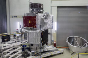 ESA unveiled its BepiColombo probe July 6 in The Netherlands. Shown above is the  Mercury Transfer Module (sitting on top of a cone-shaped adapter, and with one folded solar array visible to the right); the Mercury Planetary Orbiter (with the folded solar array seen towards the left, with red protective cover), and the Mercury Magnetospheric Orbiter (MMO). The Mercury Magnetospheric Orbiter's Sunshield and Interface Structure (MOSIF) that will protect the MMO during the cruise to Mercury is sitting on the floor to the right. Credit: ESA