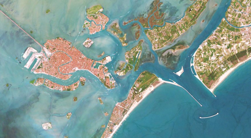 A breakwater, an artificial island, and a series of massive sluice gates in the Venetian Lagoon's Lido Inlet as seen by a RapidEye satellite.  Credit: Planet