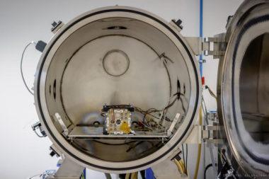 NanoAvionics staff tests the EPSS in a thermal vacuum. Credit: NanoAvionics