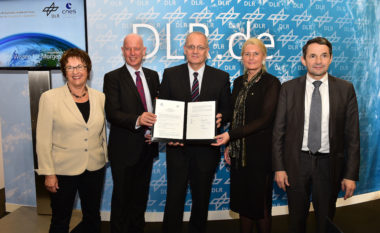 CNES President Jean-Yves Le Gall (center) and Pascale Ehrebnfreund (second from right), chair of the DLR Executive Board, renew their framework for cooperation at the Berlin airshow in July 2016. Credit: CNES