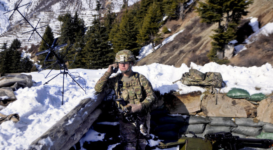 A soldier monitors the satellite communications radio along the Afghanistan-Pakistan border. (Army photo)