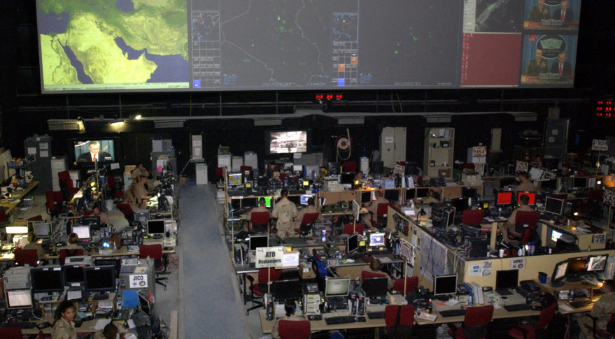 """SOUTHWEST ASIA -- The Combined Air Operations Center at a forward-deployed location is the """"nerve center"""" for aerial missions for operations Iraqi Freedom and Enduring Freedom.  CAOC officials also control humanitarian-relief missions in the Horn of Africa.  (U.S. Air Force photo by Tech. Sgt. Demetrius Lester)"""