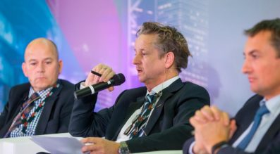 Holger Lueschow EDA's, satellite communications program manager (left) and  Hermann Ludwig Moeller, head of ESA's Institutional and European Programmes Office (center), speak at Govaatcom for European Defence and Security 2016. Credit: govsatcom.lu