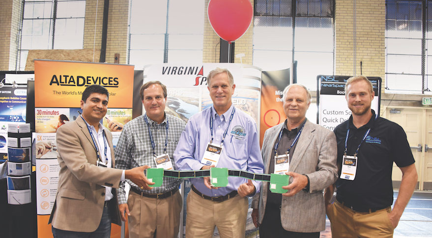 Dale Nash, executive director of Virginia Space and the Mid-Atlantic Regional Spaceport (center) and Alta Devices, Twiggs Space Lab and Near Space Launch colleagues hold three interlinked ThinSats. Credit: Alta Devices