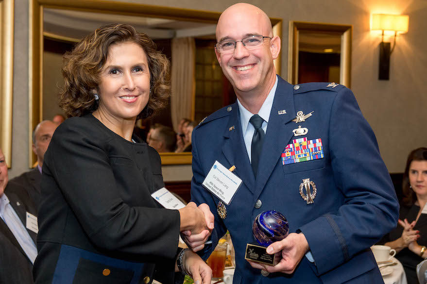 U.S. Air Force Col. Steven Lang accepts the Agency of the Year Award from SpaceNews staff writer Sandra Erwin. Credit: Kate Patterson for SpaceNews.