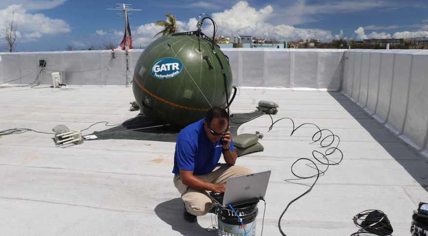 Cubic Corporation's Victor Vega installs GATR Technologies' inflatable antenna on rooftop of City Hall in Vieques, Puerto Rico. (Cubic Corporation)