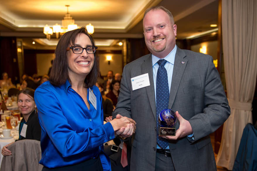 NASA's Jason Crusan accepts the Unsung Hero of the Year Award from SpaceNews correspondent Debra Werner. Credit: Kate Patterson for SpaceNews