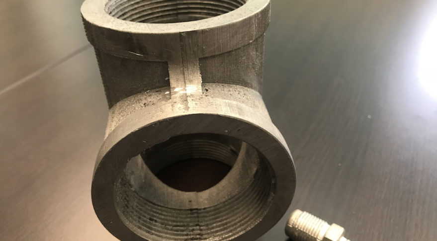 Made In Space produced these tin-bismuth cast metal pipe fittings to demonstrate the type of components it could produce in orbit. (Made In Space)