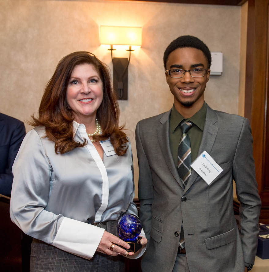 Maxar's Marcy Steinke (left) accepts the Deal of the Year Award from SpaceNews staff writer Caleb Henry. Credit: Kate Patterson for SpaceNews.