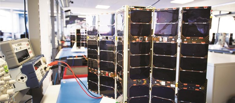 One of Spire's three-unit cubesats undergoes testing at the San Francisco-based company's lab. (Credit: Spire)