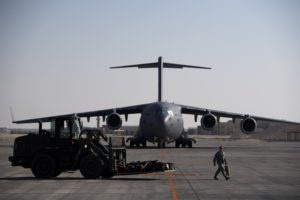 U.S. Air Force crew chiefs assigned to the 379th Expeditionary Aircraft Maintenance Squadron direct a forklift to load cargo onto a C-17 Globemaster III at Al Udeid Air Base, Qatar, Dec. 21, 2017. The 379th EAMXS is a total force team comprised of Airmen and aircraft from more than 70 different active duty, guard, and reserve force providers supporting six different airframes. (U.S. Air Force photo by Staff Sgt. Paul Labbe)