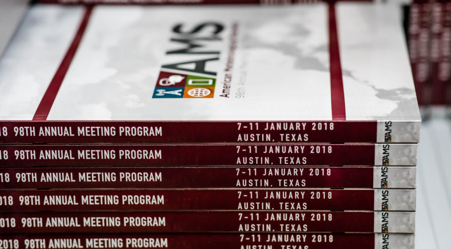 A stack of programs await attendees of the American Meteorological Society's 98th annual meeting in Austin, Texas. Credit: AMS via Flickr