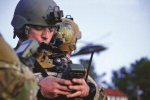 A U.S. Air Force airman plugs coordinates into a Defense Advanced GPS Receiver, or DAGR. (Credit: U.S. Defense Department)