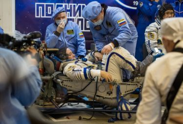 Russian technicians check NASA astronaut Scott Tingle's pressure suit ahead of his Dec. 17 launch to the ISS aboard a Soyuz capsule. (Credit: NASA/Joel Kowsky)
