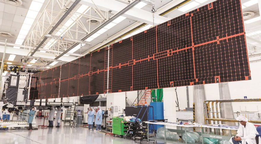 Boeing employees extend the solar panels on Intelsat-35e, which launched last July on a SpaceX Falcon 9 rocket. Credit: Boeing