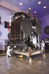Orbital ATK technicians put the finishing touches on GovSat-1. (Credit: Orbital ATK)