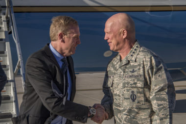 U.S. Air Force Gen. Jay Raymond (right), commander of Air Force Space Command, welcomes Deputy Secretary of Defense Patrick Shanahan (left) to Peterson Air Force Base, Colorado, Feb. 5, 2018. (Credit: USAF)