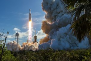 A SpaceX Falcon Heavy lifts off from Kennedy Space Center's Launch Complex 39A on its inaugural flight Feb. 6. Credit: SpaceNews / Craig Vander Galien