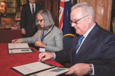 Kedell Worboys, St. Helena's U.K. representative, and Nevin Mimica, commissioner for international cooperation and development, sign an agreement Feb. 23 in Brussels concerning the subsea cable project. Credit: St. Helena Government