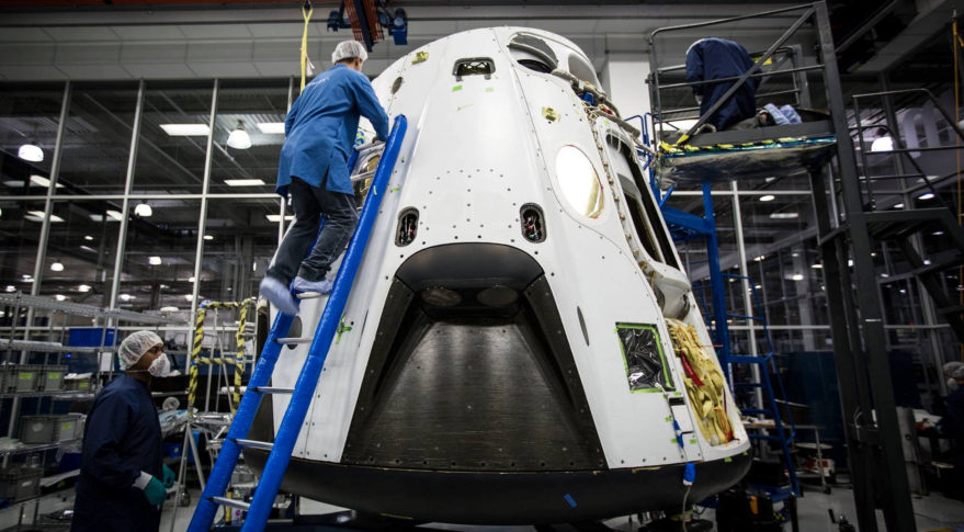 SpaceX technicians work on an abort-test test article in 2015. Credit: SpaceX