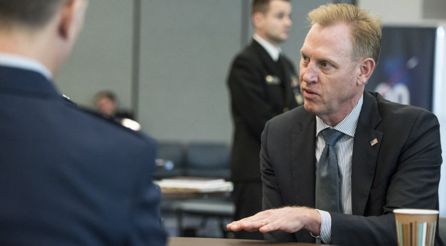 Deputy Defense Secretary Patrick Shanahan speaks with staff members before a National Space Council meeting at the John F. Kennedy Space Center Feb. 21, 2018. Credit: DoD