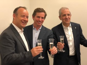 Jean Loïc Galle of Thales Alenia Space, Jason Andrews of Spaceflight Industries and Luigi Pasquali of Telespazio toast the agreement among the companies that includes Thales Alenia and Telespazio investing in Spaceflight. Credit: SpaceNews/Brian Berger