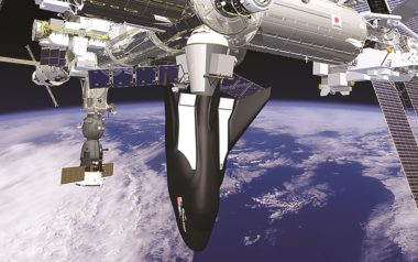 Illustration of a cargo version of Dream Chaser docked to the International Space Station. Credit: Sierra Nevada Corp.