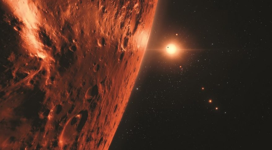 U.S.-European collaboration led to the discovery of  the TRAPPIST-1 planetary system. This artist's impression shows the view from the surface of one of the seven or more planets orbiting the ultracool dwarf star 40 light-years from Earth. Credit: ESO/N. Bartmann/SpaceEngine.org