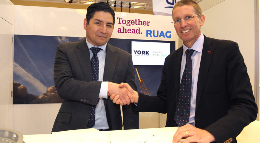 Dirk Wallinger, York Space Systems chief executive, and Peter Guggenbach, RUAG Space chief executive, signed an agreement April 17 on RUAG payload adapters for York satellites.