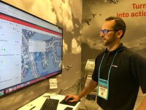 Josh Nauman, Harris chief solutions engineer demonstrates Distributed, All-source Geospatial analytics Resource at the 2018 GEOINT Symposium in Tampa, Florida. Credit: SpaceNews/Debra Werner