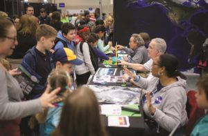 Experts say space companies need to reach future recruits well before college. Outreach efforts like the USA Science and Engineering Festival, held in Washington in early April, is a good start. Credit: NASA