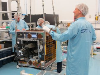 Technicians at SSTL work with the Carbonite-2 satellite in late 2017. Credit: SSTL via Twitter