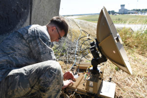 Airman 1st Class Jonathan Pooser, cyber transport technician assigned to the 1st Combat Communication Squadron, adjusts the settings on a satellite at the 31st Tactical Air Base in Poznan-Krzesiny, Poland, June 8, 2018. This satellite provides secure communications allowing the pilots to communicate during the BALTOPS exercise and the U.S. Army Europe led exercise, Saber Striker 18. (U.S. Air Force photo by Airman 1st Class Christopher S. Sparks)