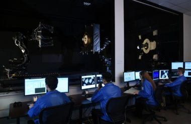 Technicians at Orbital ATK put Mission Extension Vehicle-related hardware through its paces. Credit: Orbital ATK