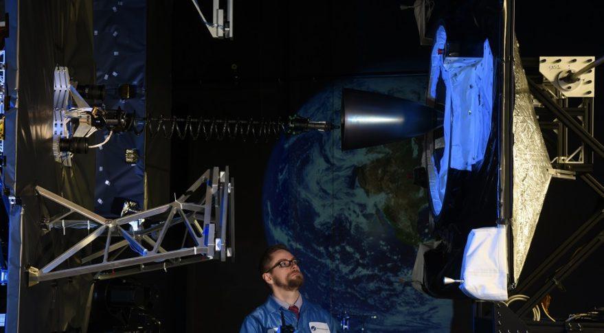 An Orbital ATK technician monitors a ground demonstration of MEV docking systems. Credit: Orbital ATK