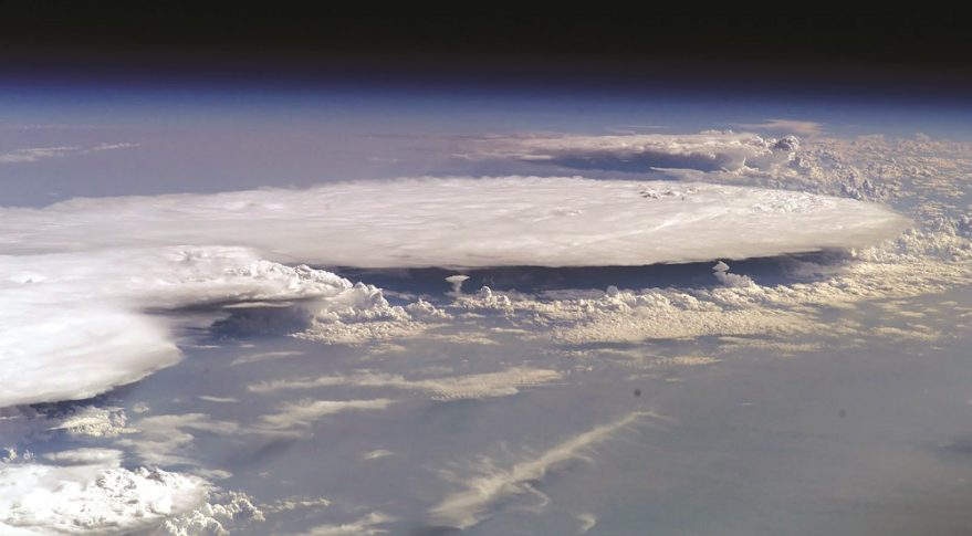 This image from the ISS shows strong tropospheric storm clouds pushing up against and being blocked at the tropopause, illustrating the decoupled and isolated nature of the stratosphere from the troposphere below. This relative isolation allows rocket emissions to accumulate in the stratosphere. Credit: NASA