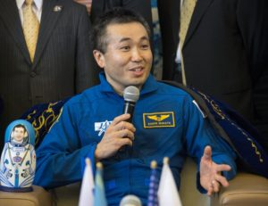 Koichi Wakata, JAXA vice president and director general for Human Spaceflight Technology, is shown answering media questions at Karaganda Airport in Kazakhstan in 2014 after he commanded International Space Station Expedition 39. Credit: NASA/Bill Ingalls