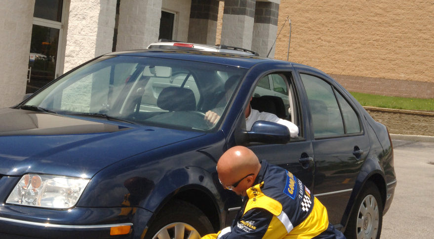 A Goodyear service technician checks tire pressure. For passenger cars, ten to 14 percent of fuel consumption is used to roll tires on the road. Goodyear is investigating how silica combined with rubber improves tire efficiency. Credit: Goodyear Tire & Rubber Co.