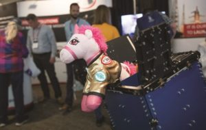 "A ""space unicorn"" on display at the ISIS (Innovative Solutions in Space) exhibit at the Small Satellite Conference at Utah State University in Logan, Utah Aug. 7, 2018. Credit: Keith Johnson for SpaceNews"